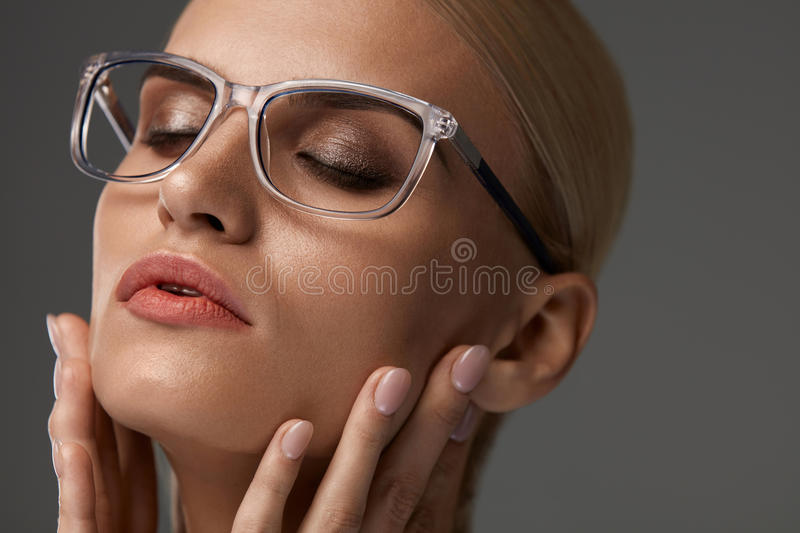 Women Fashion Glasses. Girl In Stylish Grey Eyeglasses, Eyewear. Women Fashion Glasses. Beautiful Young Female Wearing Stylish Optical Eyeglasses On Grey royalty free stock image