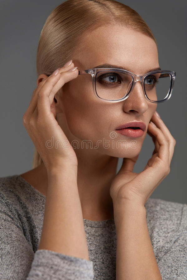 Women Fashion Glasses. Girl In Stylish Grey Eyeglasses, Eyewear. Women Fashion Glasses. Beautiful Young Female Wearing Stylish Optical Eyeglasses On Grey royalty free stock photography