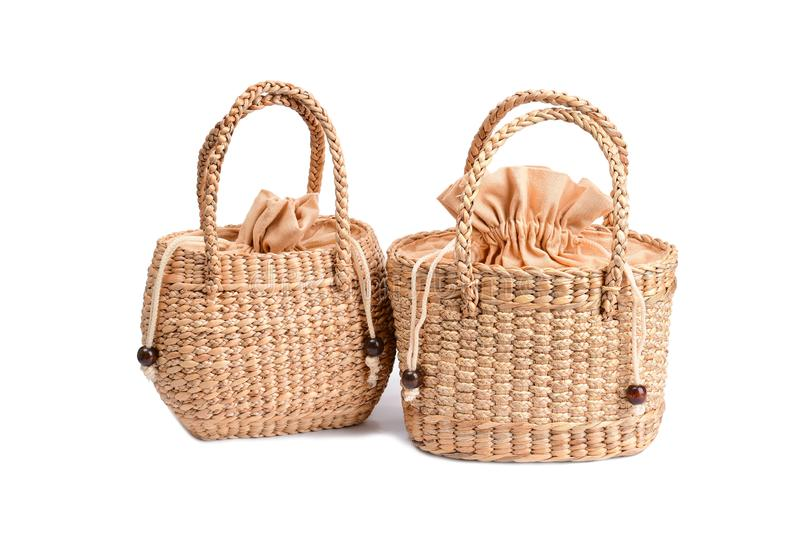 Women fashion handbag with Woven or straw bag handmade bag Thai handicraft weave from natural materials. For caring environment reduce the use of plastic bags royalty free stock photos
