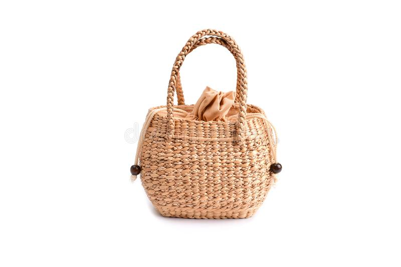 Women fashion handbag with Woven or straw bag handmade bag Thai handicraft weave from natural materials. For caring environment reduce the use of plastic bags royalty free stock photography