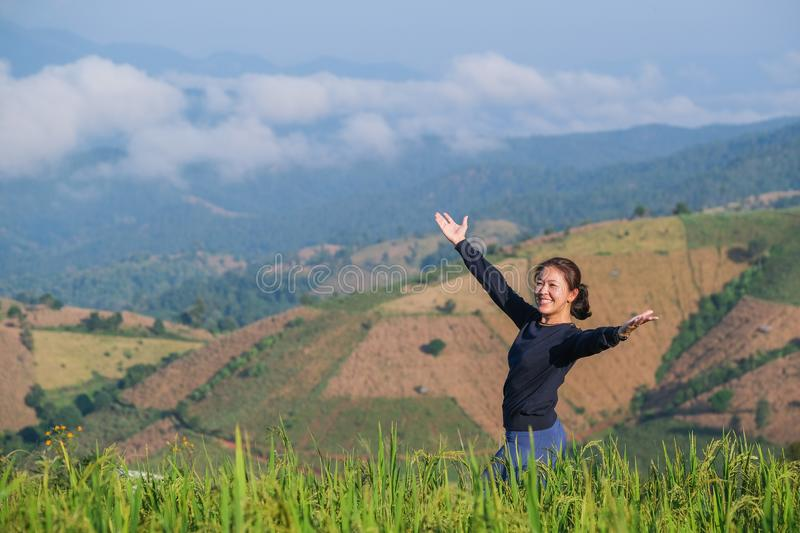 Women feel free surrounded by the colors of the mountains and rice fields in morning stock images
