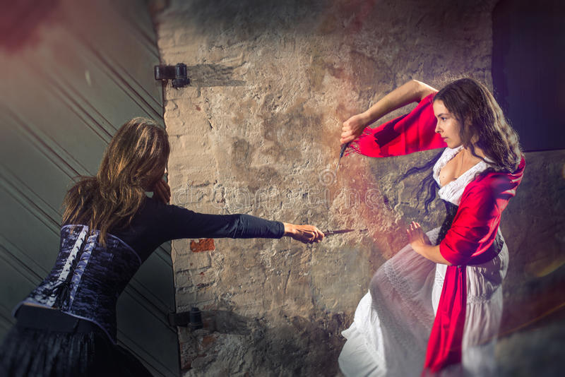 Women fighting with knives royalty free stock photos