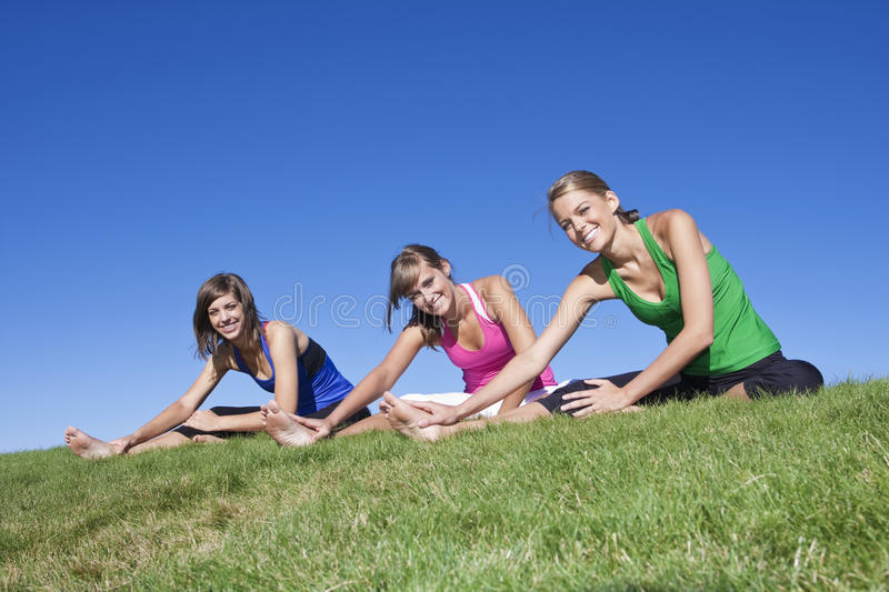 Women fitness and exercise. A group of Beautiful young women stretching before fitness and yoga royalty free stock images