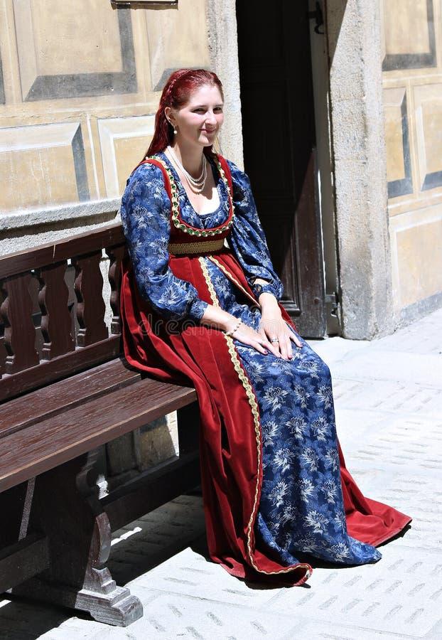 Women on Five-petalled Rose Festival on bystreet in Cesky Krumlov royalty free stock image