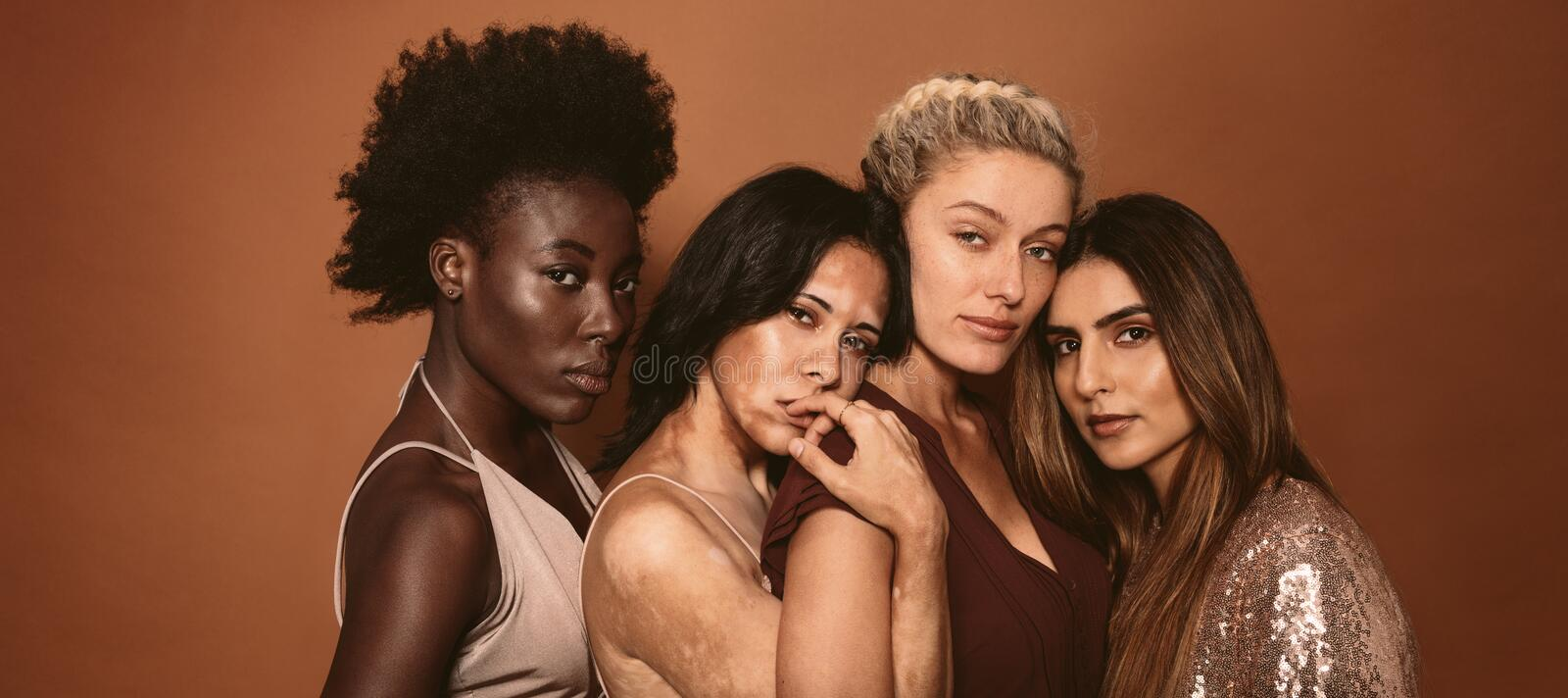 Women friends with different skin types stock image