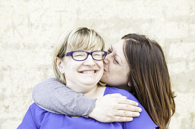 Women friends kiss royalty free stock photography