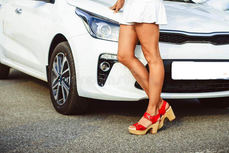 Women in front of car stock photography