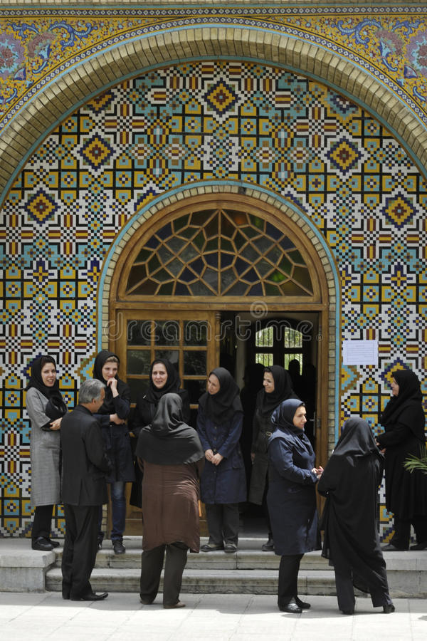 Women gathered at the praying room gate stock photos