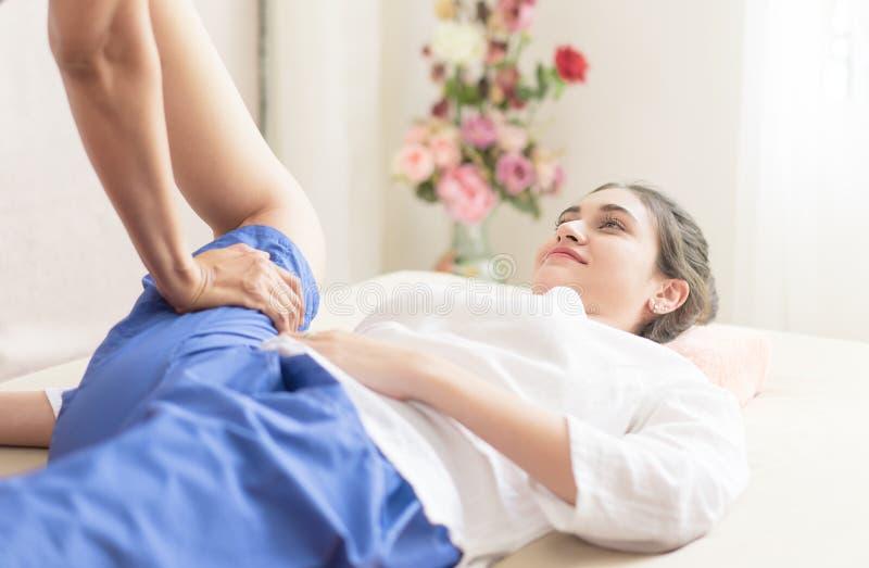 Women getting leg stretch in Thai massage stock photo