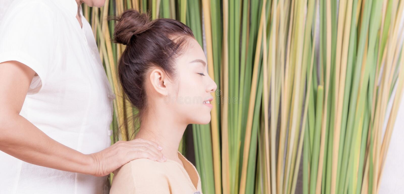 Women is getting neck shoulder massage. Women is getting neck and shoulder massage royalty free stock image