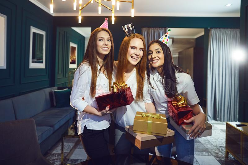 Women with gifts while having birthday party royalty free stock photos