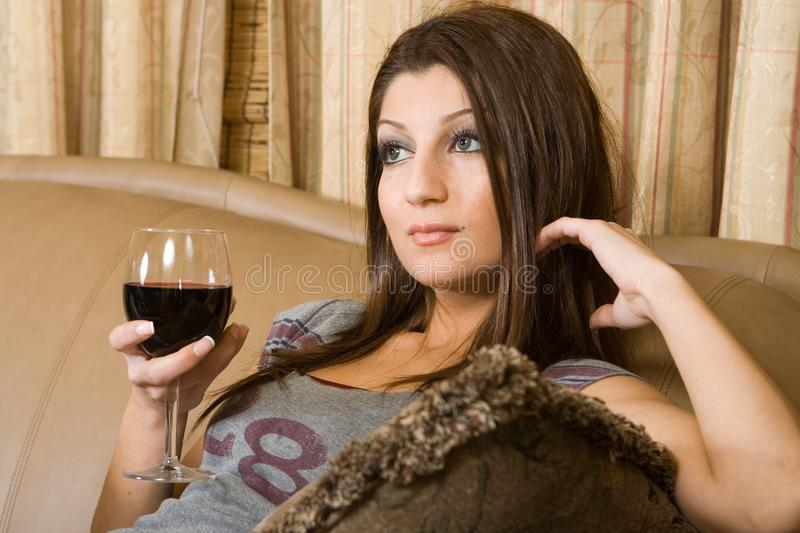 Women in a glass of red wine stock image