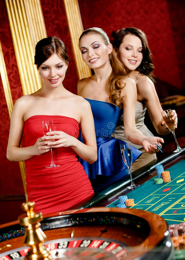 Download Women With Glasses Of Spirits Play Roulette Stock Image - Image: 28979487