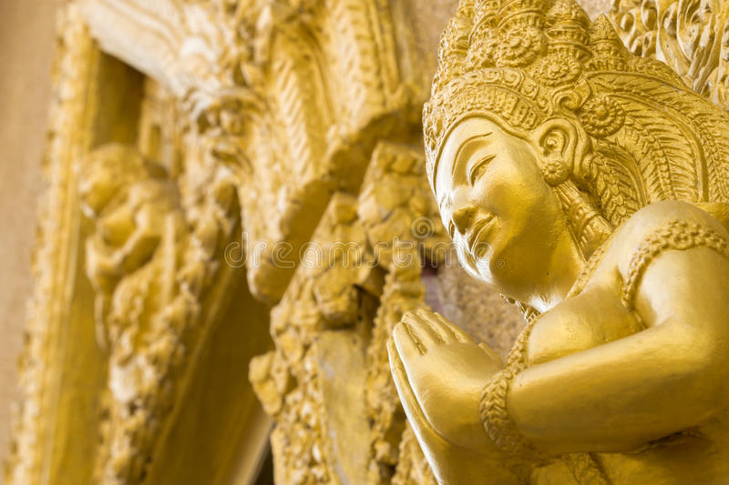 Women gold statue pray in temple. Ubonratchathani Thailand.  royalty free stock photography