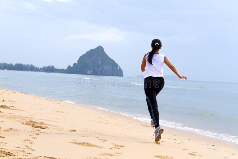 Women good shape morning running on beach stock photos