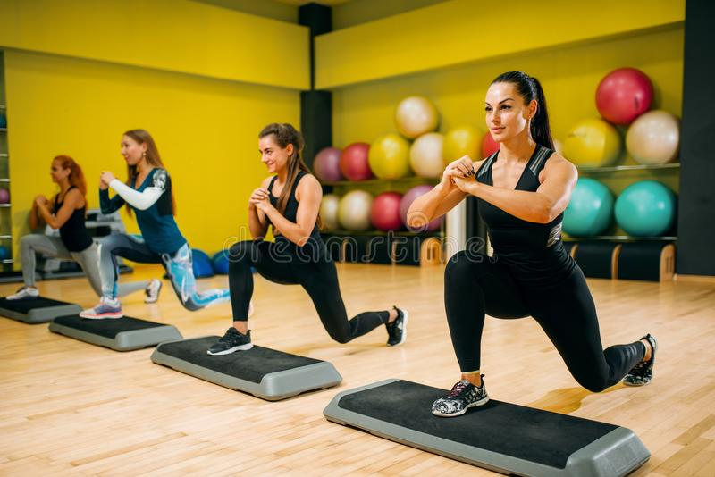 Women group on step aerobic workout stock photography