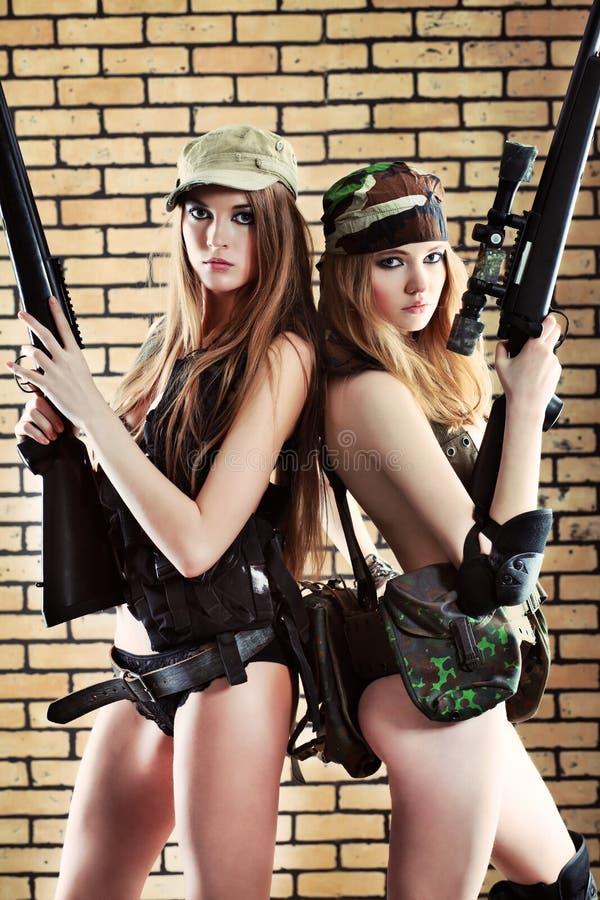 Women with guns royalty free stock photos