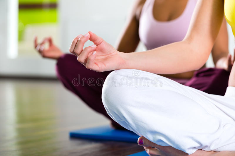 Women in the gym doing yoga exercise for fitness royalty free stock photos