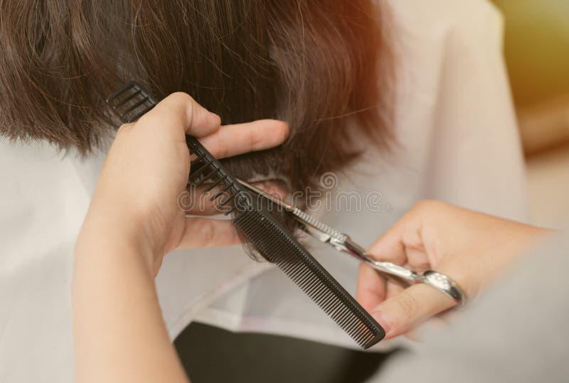 Women hair cutting stock photography