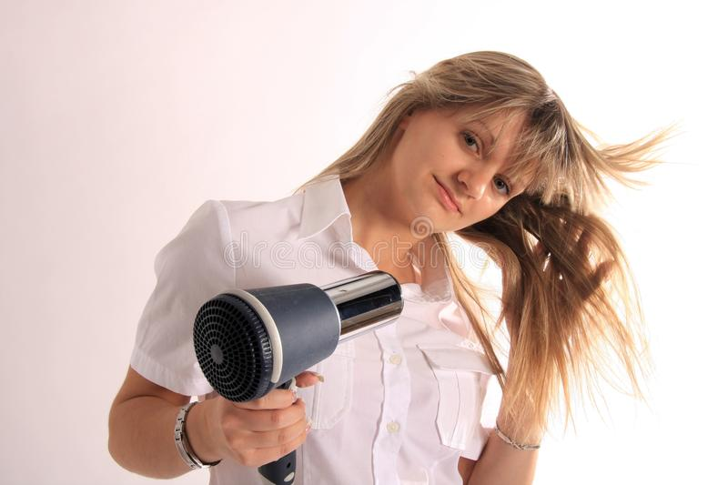 Women with hairdryer royalty free stock photos