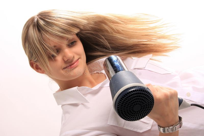 Women with hairdryer royalty free stock photo