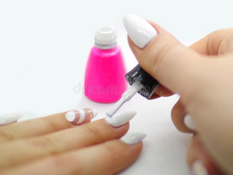 Woman Painting Long Nails With A White Nailpolish Stock Image ...
