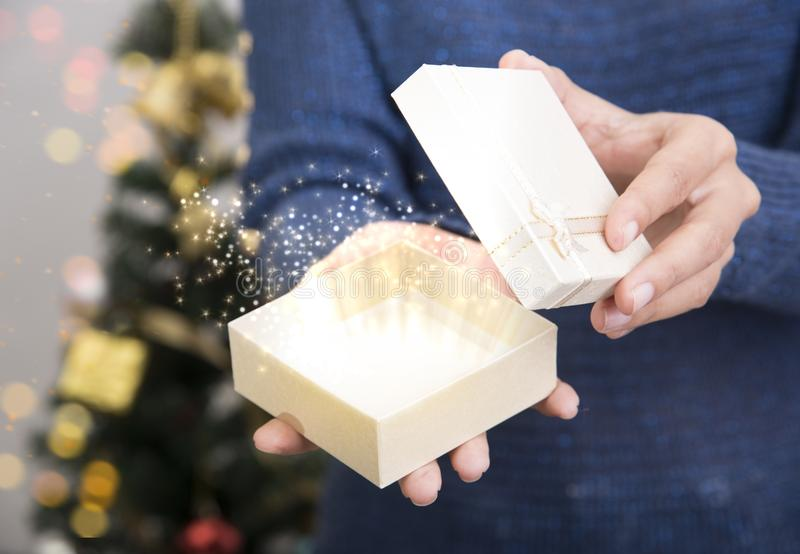 Women hand open gift box. Women hand open Christmas special gift box royalty free stock photo