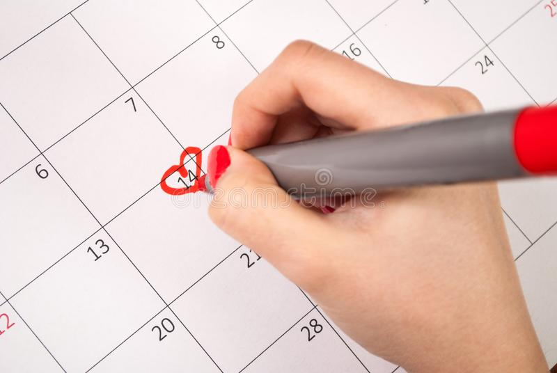 Line Drawing Heart Shape : Women hand with pencil drawing heart shape in calendar for