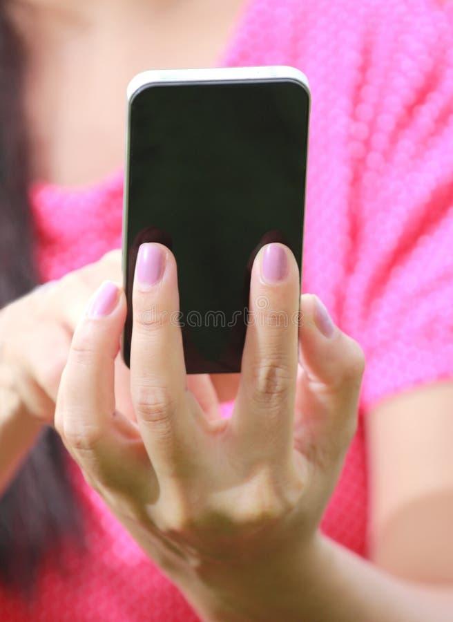 Women Hand using smartphone. Women pink shirt using smartphone stock photos