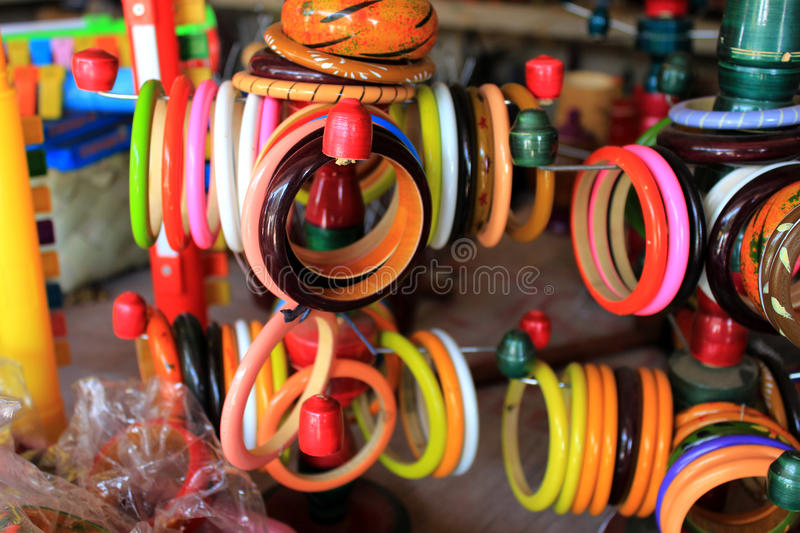 Women handmade bracelet, exposed for sale. Colorful handcraft made by mud stock photography