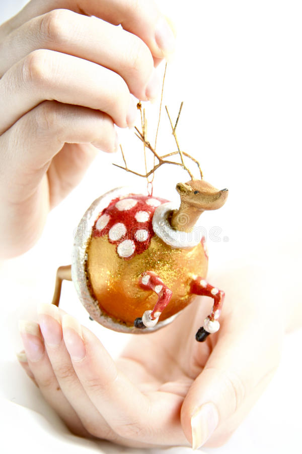 Women Hands Holding Christmas toy