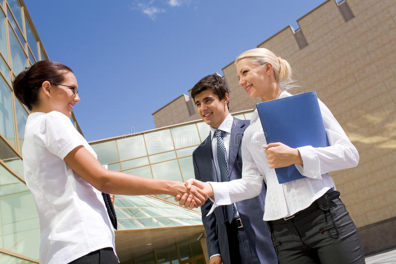 Women handshaking. Photo of successful partners handshaking after striking deal at meeting stock images