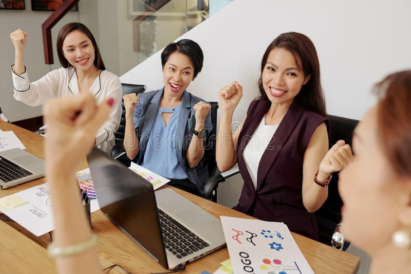 Women happy with their success stock image