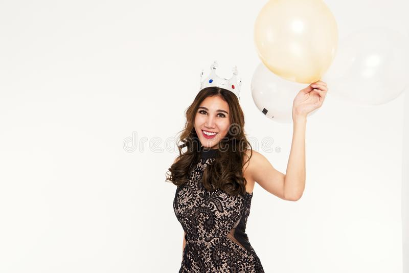 Women have fun and enjoyment in the happy new year party with balloon decoration on white background stock photo
