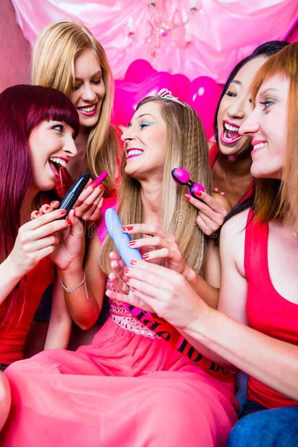 Women having bachelorette party with sex toys. In night club royalty free stock image