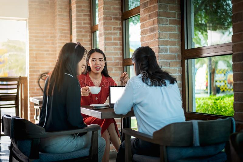 Women having a coffee in the bar. Women having a coffee and talking in the bar asian chinese lifestyle young people friends friendship attractive happy female stock photo