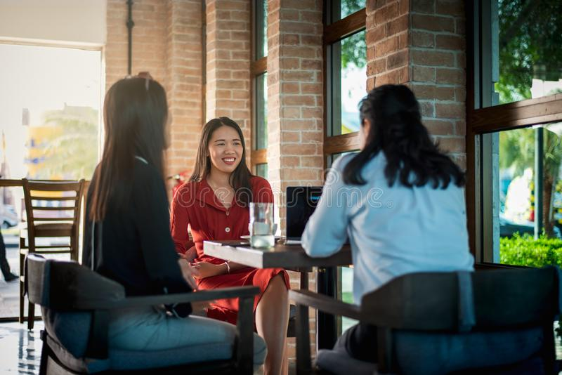 Women having a coffee in the bar. Women having a coffee and talking in the bar asian chinese lifestyle young shop people cafeteria friends friendship attractive stock images