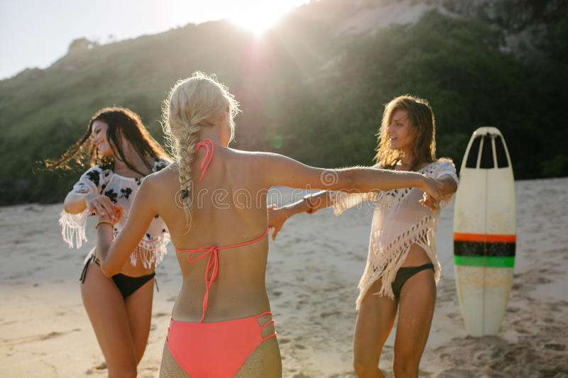 Women having fun on the beach party. Happy female friends partying on the beach and dancing. Women having fun on the beach party stock photography