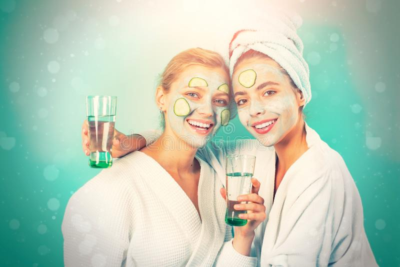 Women having fun cucumber skin mask. Relax concept. Beauty begins from inside. Spa and wellness.  stock photography