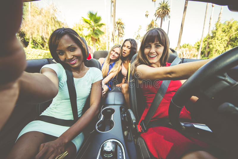 Women having fun while driving in Beverly hills royalty free stock images