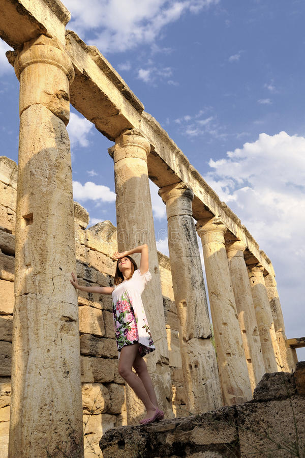 Women is history between the columns. In hierapolis stock photography