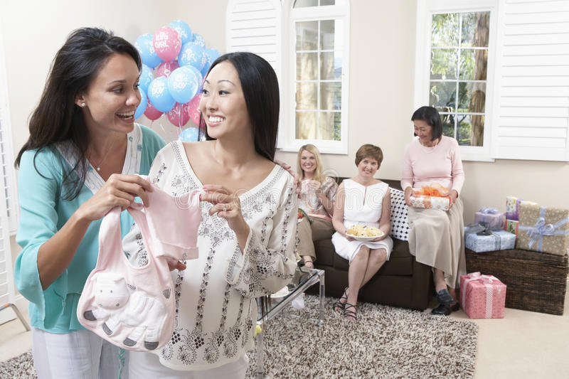 Women Holding Baby Clothes At Baby Shower Stock Photo Image Of