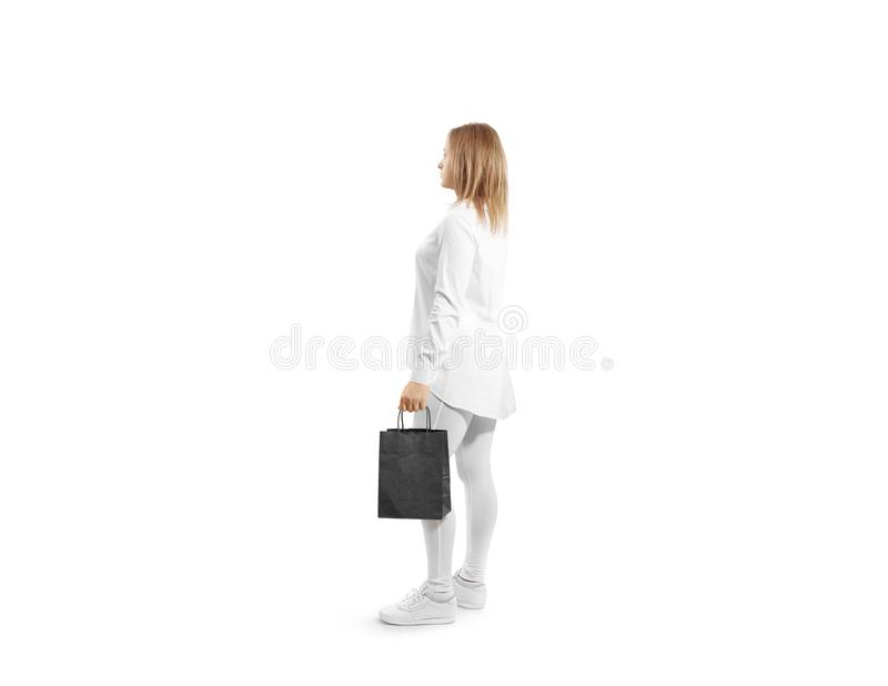 Women holding blank black craft paper bag design mock up. In hand. Woman hold kraft textured purchase pack mock up. Clear shop bagful branding template stock images