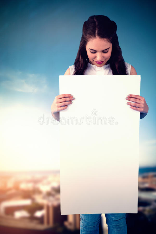 Composite image of women holding blank poster royalty free stock photos