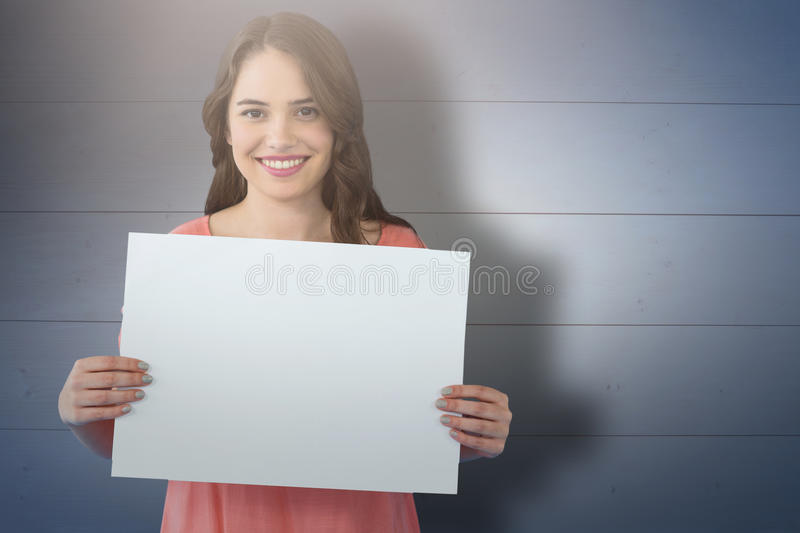 Composite image of women holding blank poster royalty free stock photo