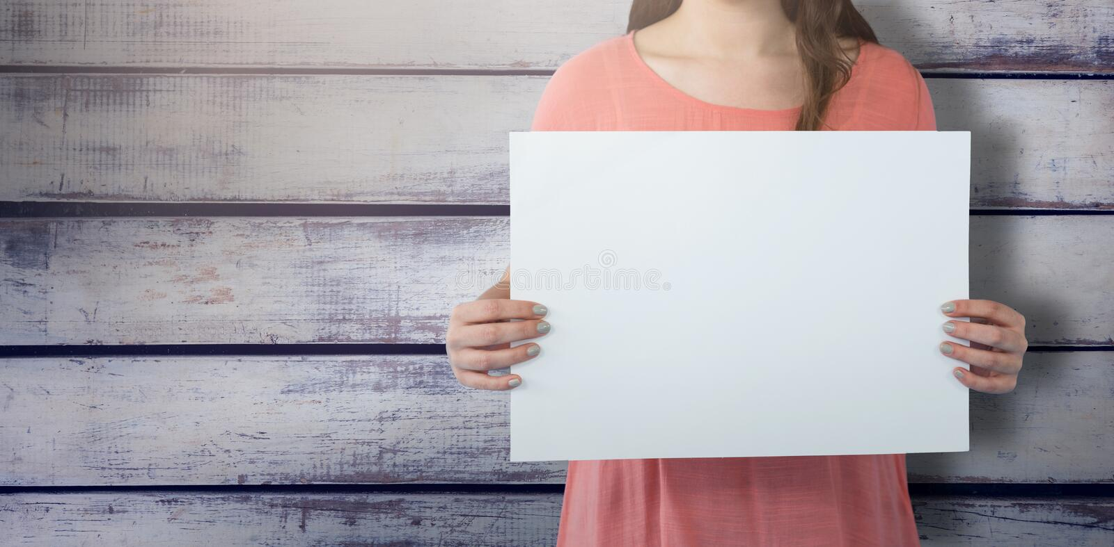 Composite image of women holding blank poster stock photos