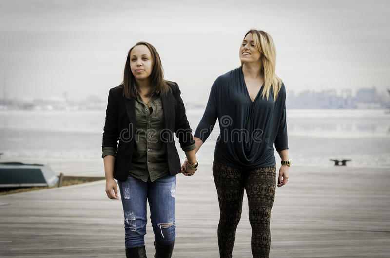 Women holding hands royalty free stock photo
