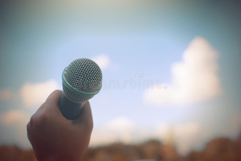 Download Women Holding Microphone With Instagram Like In Cross Processing. Stock Image - Image of stage, hand: 83721299