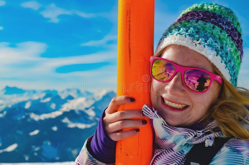 Women Holding onto Ski Post on the Sloops royalty free stock images