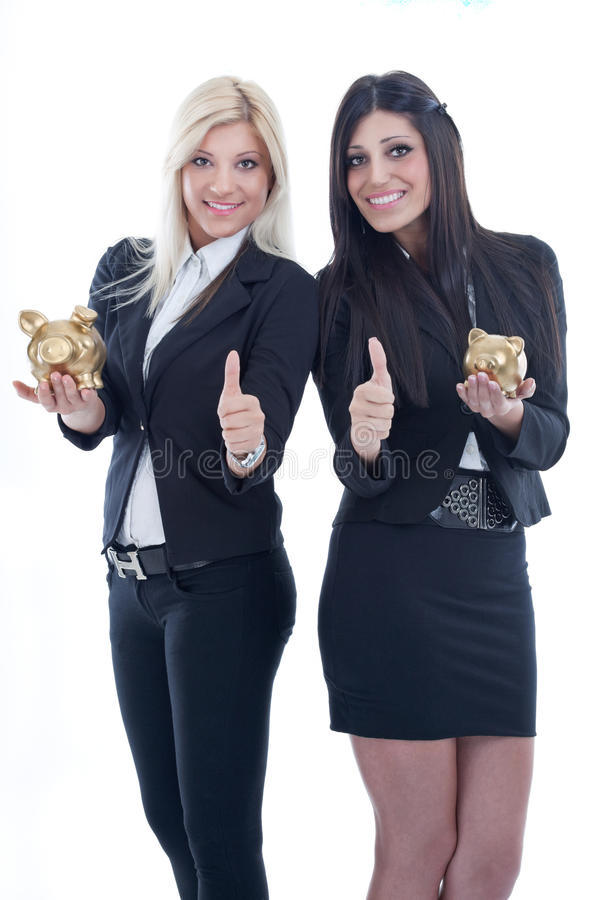 Women holding piggy bank stock photography